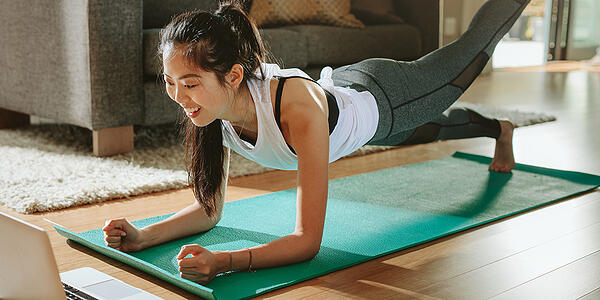 Woman working out at home watching a video