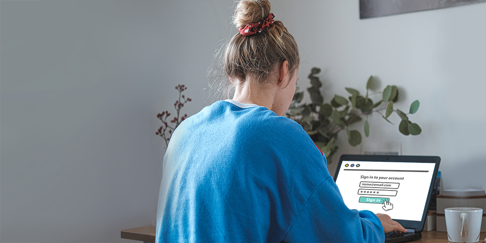 Woman working on laptop in her home office