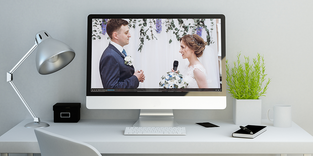 Wedding being live streamed on a computer