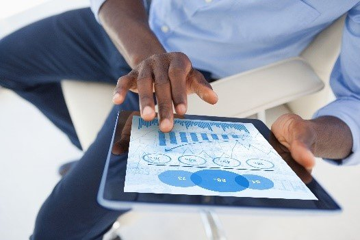 Businessman looking at analytics on tablet
